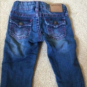 True religion blue jeans pink stitching flap